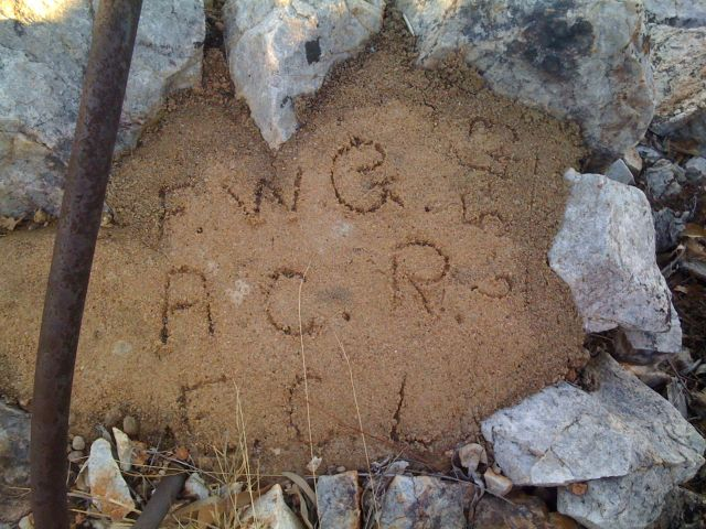 Initials in the concrete of one of the machine gun pits.